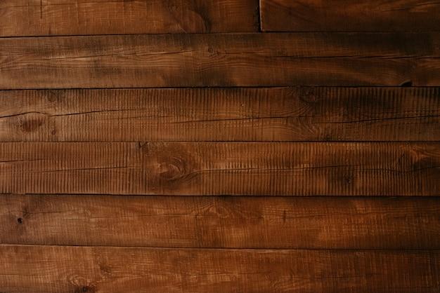 自然なパターンの質感を持つ板の木製テーブルの床を閉じます。コピースペースを持つ木の板の背景。