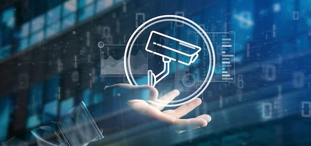 Бизнесмен держит значок системы безопасности камеры и статистические данные -