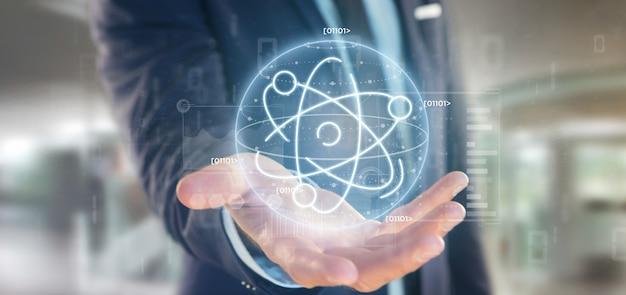 データに囲まれた原子のアイコンを保持している実業家