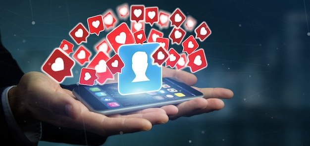 Бизнесмен держит лайк уведомления о контакте в соцсетях