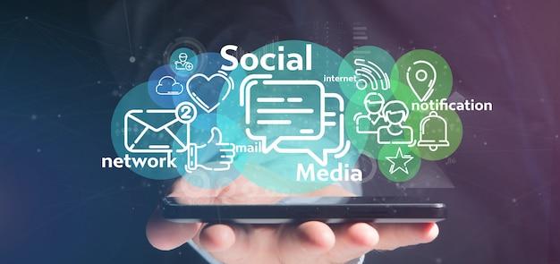 ソーシャルメディアネットワークアイコンの雲を保持している実業家