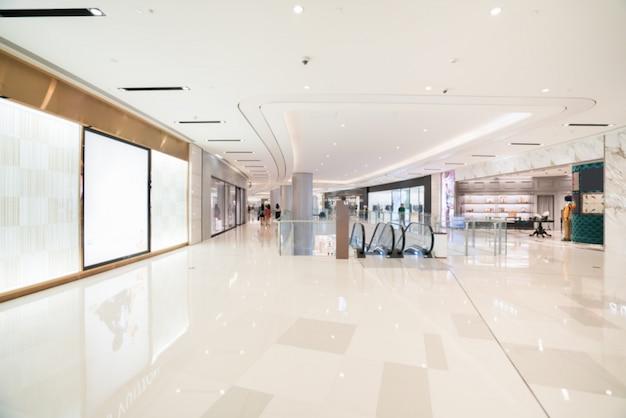 Абстрактный размытия и расфокусированным торговый центр в интерьере универмага для фона
