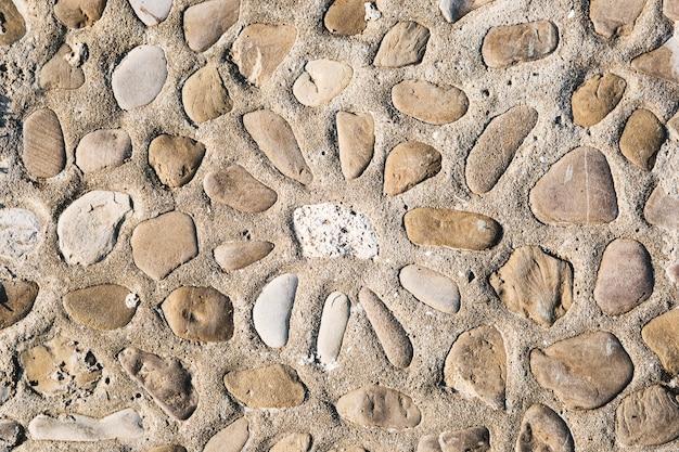 太陽の飾りと石畳の通り床のテクスチャの平面図です。
