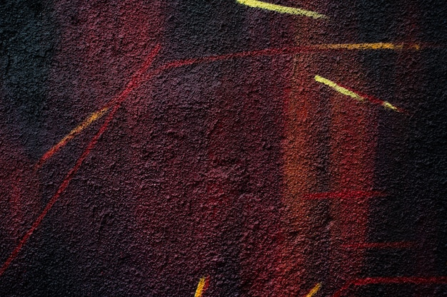 アスファルトの上の抽象的なカラーパターン。粒子の粗い背景