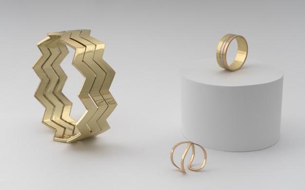 Современный золотой браслет в виде зигзага с двумя кольцами на белом
