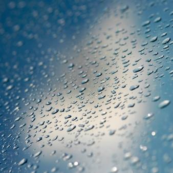 ガラスの反射自動車の背景水分