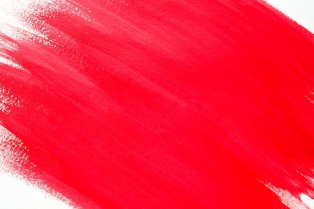 白いシートに抽象的な赤いペンキ