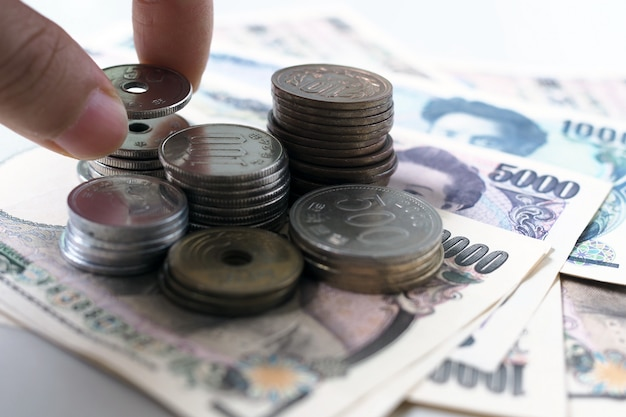 Японская иена отмечает и японские иены монеты для денег концепции фон