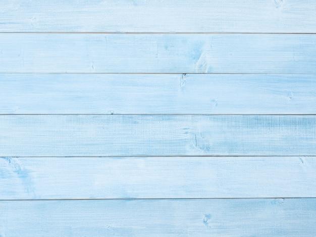 Голубая светлая деревянная текстура или предпосылка. пастельно-синий деревянный стол.