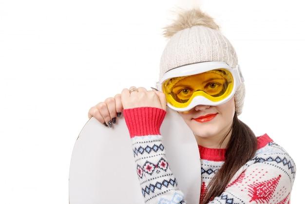 スノーボードと美しい女性