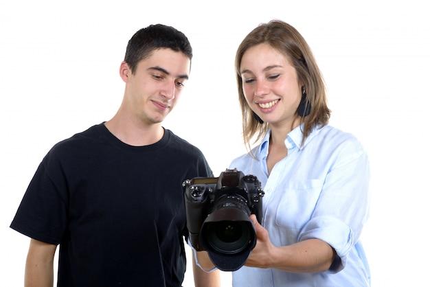 きれいな女性の写真家と学生