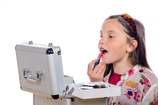 メイクアップボックスを持つ少女