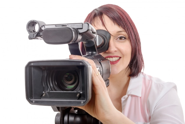 Милая молодая женщина с профессиональной камерой