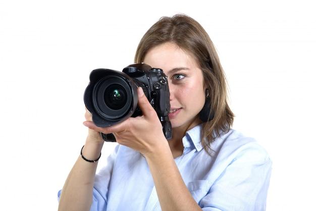 デジタルカメラで写真を取っている女の子