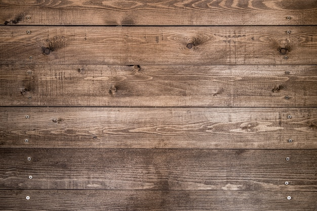 グランジスタイルの暗い天然木で作られた古い茶色の木製の背景。松の自然な生の平面テクスチャー。フラットレイを撮影するためのテーブルの表面。コピースペース。