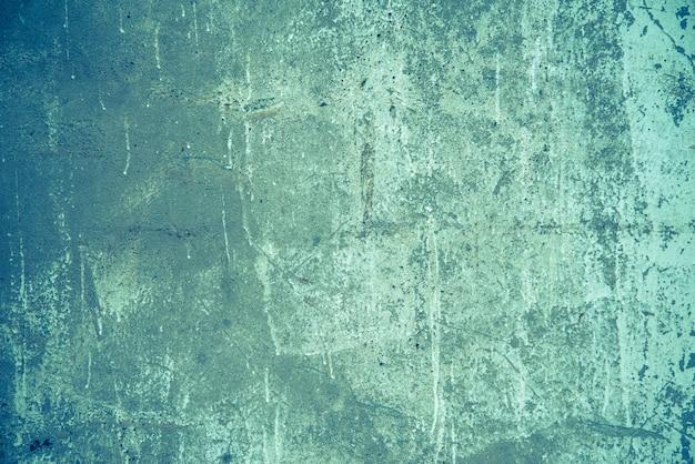 織り目加工のビンテージブルー傷壁。グランジスタイルのコンクリートネオントーンの背景。