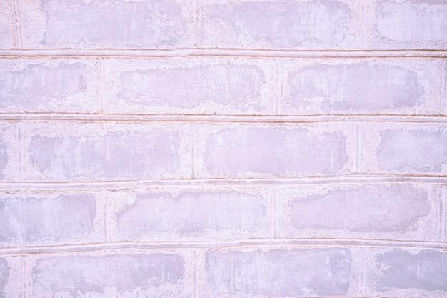Розовый старый неоновый конец-вверх кирпичной стены с швом. фоновая текстура каменной кладки.