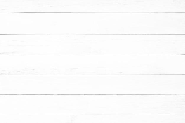 Светлый белый деревянный фон из натурального дерева. вид сверху. натуральная необработанная строганная текстура пород сосны. поверхность стола для выстрела плоско лежала. копировать вставить