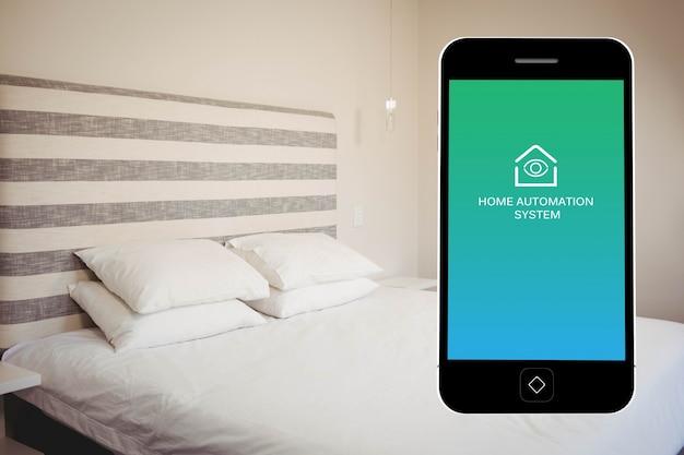 寝室の背景を持つスマートフォン