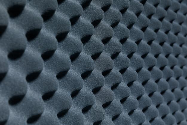 Крупный план звукоизоляционного покрытия в музыкальной студии, звукоизоляционное покрытие в студии звукозаписи для фона, звукоизоляция для музыкальной студии звукозаписи