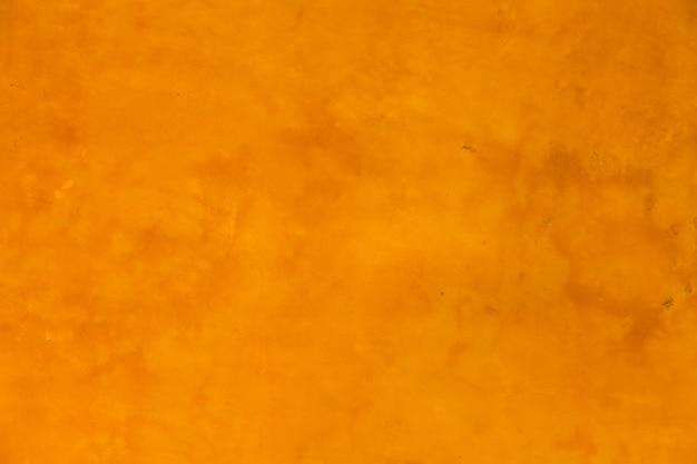 黄色のコンクリートの壁のパターンと