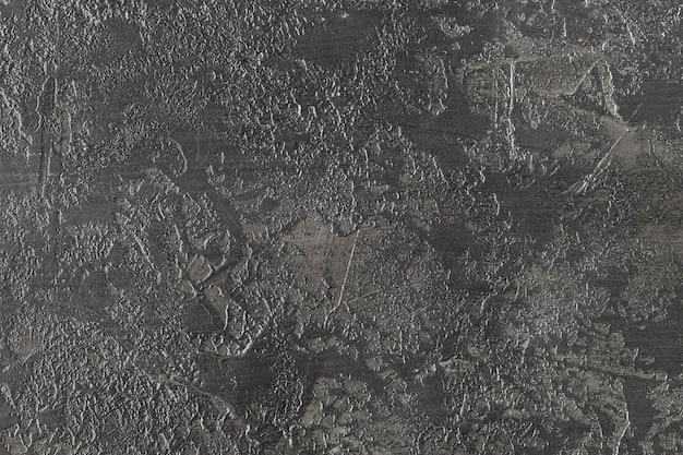暗い灰色のコンクリートテクスチャ。灰色の漆喰の背景
