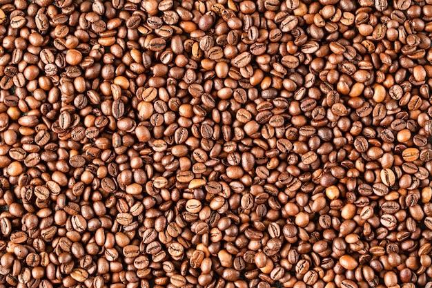 Жареный кофе в зернах, можно использовать в качестве фона