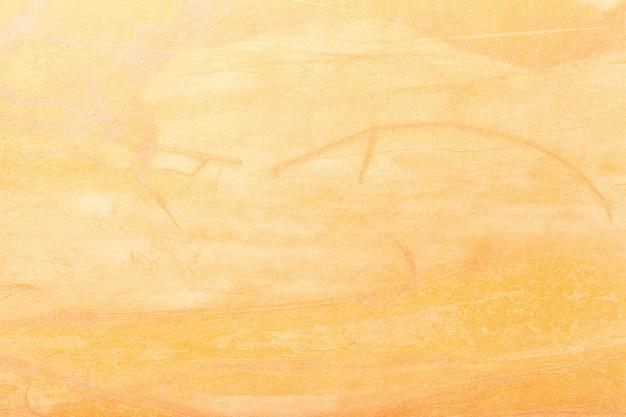 抽象芸術の背景の黄金色。キャンバス上の多色塗装。