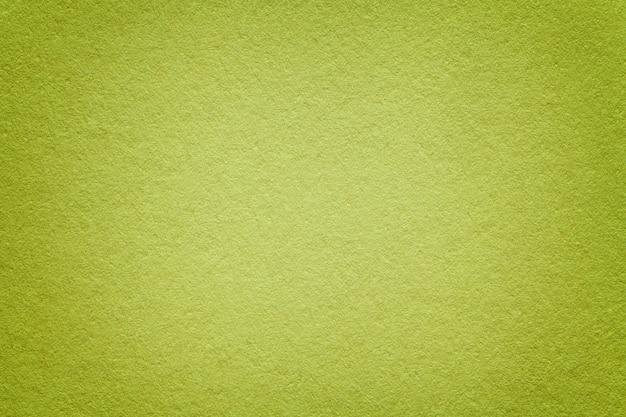 古い緑の紙の背景のテクスチャ