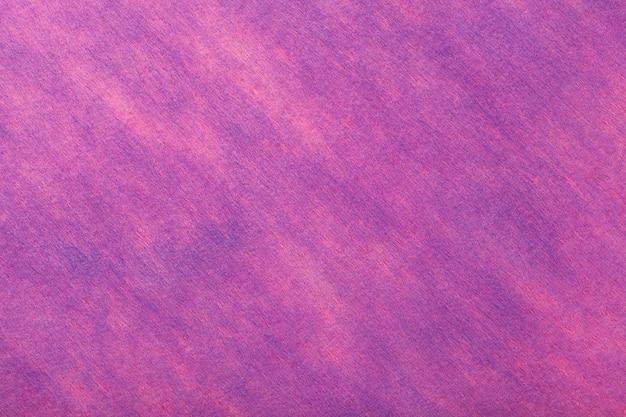 フェルト生地の濃い紫とピンクの背景、ウール織物の質感