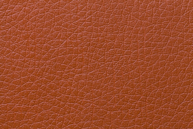 パターン、クローズアップとオレンジ色の革テクスチャ背景