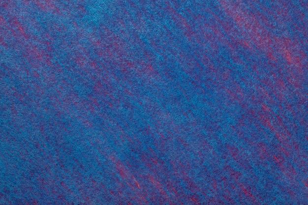 フェルト生地の紺色の背景。ウール織物のテクスチャ