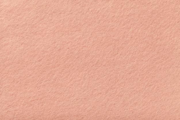 ライトピンクのマットスエード生地のクローズアップ