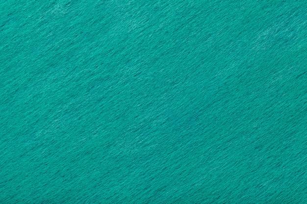 フェルト生地の明るい青緑色の背景