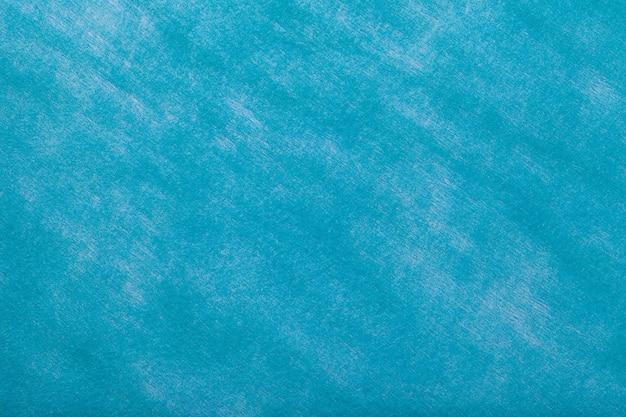 フェルト生地の明るい青の背景