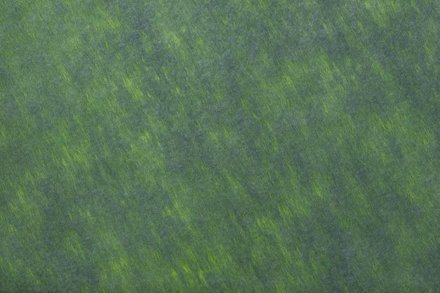 フェルト生地の濃い緑色の背景