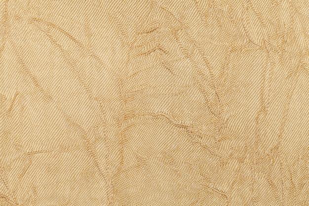 繊維材料から明るいベージュの背景