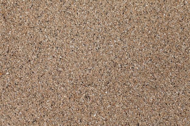 海海岸のテクスチャ背景の乾燥砂。
