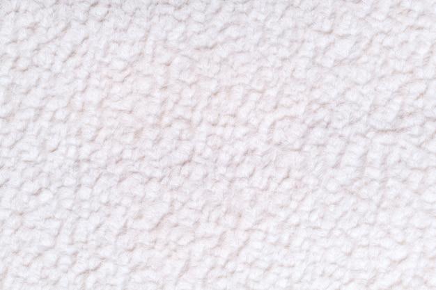 柔らかく、フリースの布の白いふわふわの背景