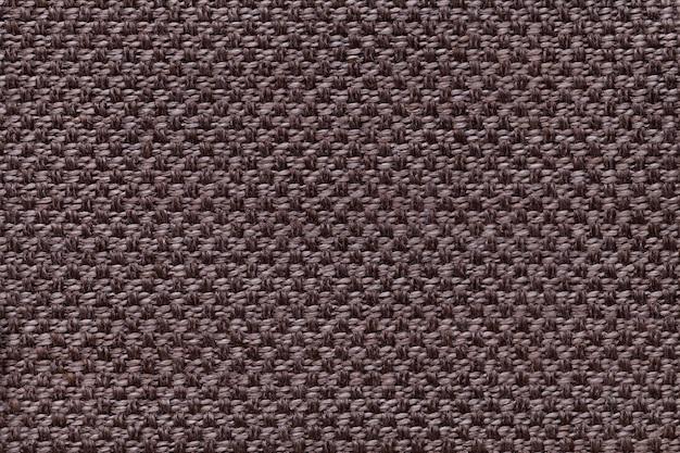 市松模様の暗い茶色の繊維の背景。