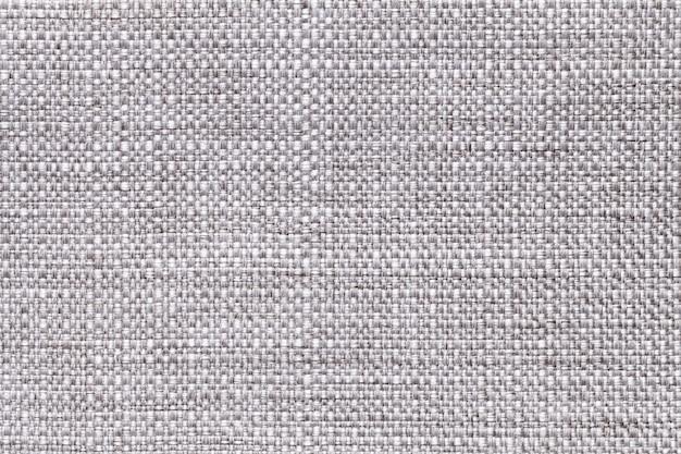 灰色の繊維の背景のクローズアップ