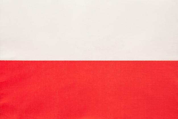 ポーランドの国民の生地の旗、繊維の背景