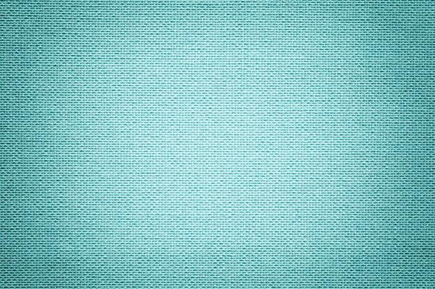 繊維材料からの明るい青の背景。自然な風合いの生地