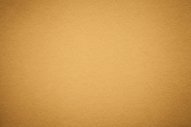 古い黄金の紙の背景のテクスチャ