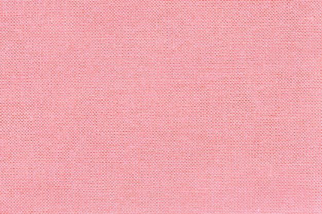 枝編み細工品パターンを持つ繊維材料から明るいピンクの背景