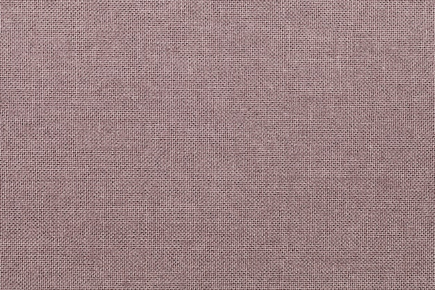 Коричневый фон из текстильного материала с плетением