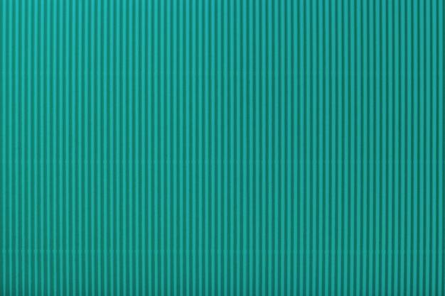 Текстура из гофрированной светлой бирюзовой бумаги
