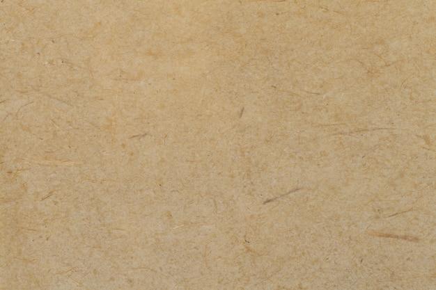 茶色の古い紙の背景、厚い段ボール、