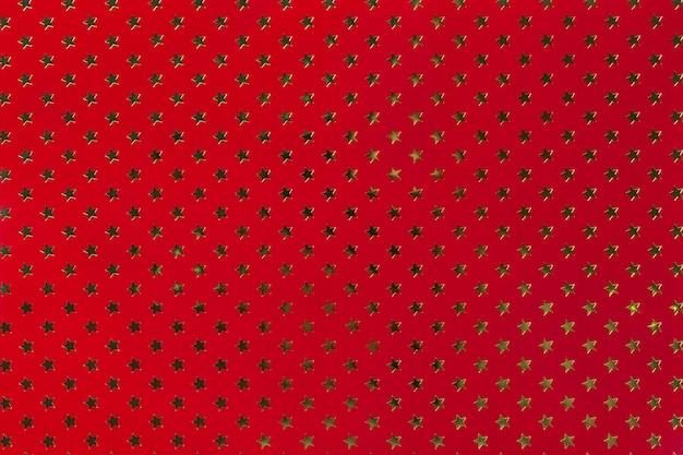 金色の星のパターンを持つ暗赤色の表面