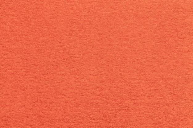 古い明るいオレンジ色の紙のテクスチャ